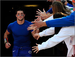 Florida fans greet Tim Tebow before his final home game at Ben Hill Griffin Stadium last Saturday. This Saturday, the Gators face Alabama for the SEC Championship.