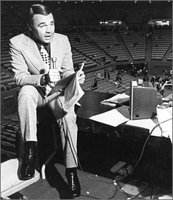 Longtime network sportscaster Dick Enberg working at Pauley Pavilion during his days as TV voice of UCLA basketball from 1966-77. Enberg is leaving CBS' NFL and college basketball coverage to concentrate on calling San Diego Padres games.
