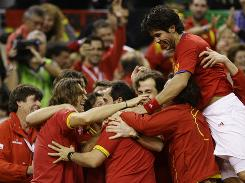 Spain's Fernando Verdasco jumps on top of teammates as they celebrate winning the Davis Cup final against the Czech Republic at the Palau Sant Jordi indoor arena Saturday in Barcelona.