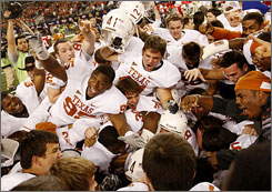 Texas players celebrate after kicker Hunter Lawrence nailed the game-winning field goal as time expired to lift the Longhorns over Nebraska in the Big 12 championship game.