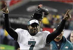 Michael Vick rushed for a TD and threw a TD pass in his return to Atlanta.