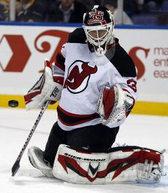 New Jersey Devils goalie Martin Brodeur stops a shot during the third period of his game against the Buffalo Sabres in Buffalo. The Devils won 3-0 and Brodeur recorded his 103rd shutout, tying the NHL record.