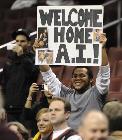 Marc Miranda of Philadelphia holds up a sign during pre-game warmups welcoming Allen Iverson back to the 76ers. Iverson made his second-stint debut for the team on Monday against the Denver Nuggets, another of his former squads.