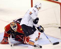 Edmonton Oilers center Shawn Horcoff scores a goal against Florida Panthers goalie Tomas Vokoun in the shootout. The Oilers won 3-2.