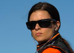 Danica Patrick driver of the No. 7 Andretti Green Racing Dallara Honda sits during qualifying for the IndyCar Series Firestone Indy 300 on Oct. 9 at the Homestead-Miami Speedway in Homestead, Fla. Patrick plans on joining NASCAR with Dale Earnhardt Jr.'s team.
