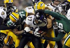 Baltimore Ravens running back Ray Rice is stopped by members of the Green Bay Packers defense during the third quarter of the teams' game Monday at Lambeau Field. The Packers won 27-14.