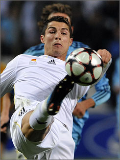 Portuguese forward Cristiano Ronaldo scored twice to help Real Madrid beat Marseille 3-1 in Group C action. Madrid finished atop Group C by four points over AC Milan.