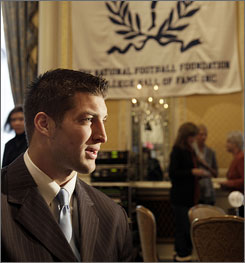 Florida quarterback Tim Tebow talks with reporters after being honored with the William V. Campbell Trophy, which honors players for academic and football success as well as community service.