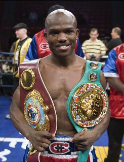 Timothy Bradley, here sporting WBC and WBO belts in April, will face Lamont Peterson for the WBO junior lightweight title Saturday in Palm Springs, Calif., which is Bradley's hometown.