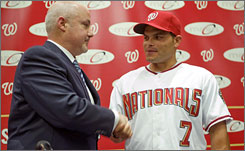 Nationals general manager Mike Rizzo shakes hands with new catcher Ivan Rodriguez at a news conference in Washington.