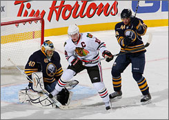 Sabres goalie Patrick Lalime, trying to defend against the Blackhawks' Jonathan Toews along with teammate Andrej Sekera, stopped 39 Chicago shots in just his third start of the season.