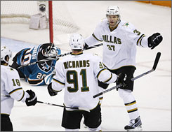 Brad Richards congratulates Stars teammate Karlis Skrastins after scoring the game-tying goal in the third period against the Sharks.