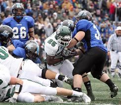 Grand Valley linebacker James Wojciechowski takes the ball from the hands of Northwest Missouri running back Previn Perry.