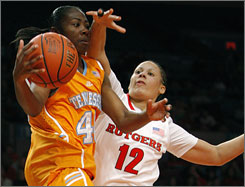 Rutgers' April Sykes closely defends Tennessee's Shekinna Stricklen during the third-ranked Lady Vols' victory at the Maggie Dixon Classic Sunday in New York.