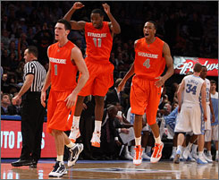 Andy Rautins, left, Scoop Jardine, center, and Wes Johnson have the Syracuse Orange playing well and are ready to contend in the Big East this year, despite losing several key players from last year's squad.