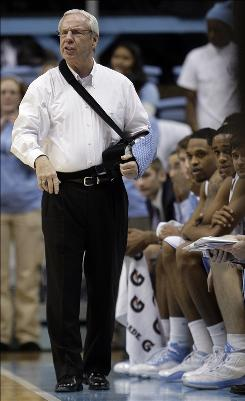 A North Carolina team spokesman says coach Roy Williams did not ask campus police to eject a fan from the Dean Smith Center.