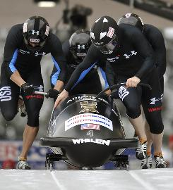 Steven Holcomb, Steve Mesler, Justin Olson and Curt Tomasevicz start on their way toward a four-man bobsled win in Winterberg, Germany.