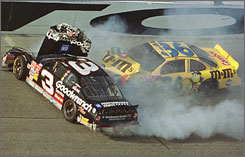 NASCAR driver Dale Earnhardt dies in a last-lap crash at the Daytona 500 in 2001.