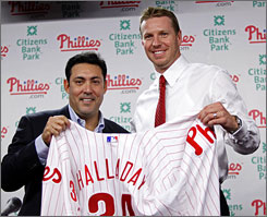 Roy Halladay, right, poses with Phillies general manager Ruben Amaro Jr. during news conference. Halladay finished 17-10 with a 2.79 ERA in 32 starts for the Blue Jays in 2009.