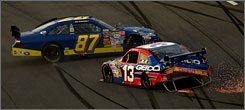 The cars of Joe Nemechek (87) and Max Papis come together in an early race crash at Darlington Raceway in May.