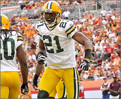 Packers CB Charles Woodson is tied for second in the NFL with eight interceptions.
