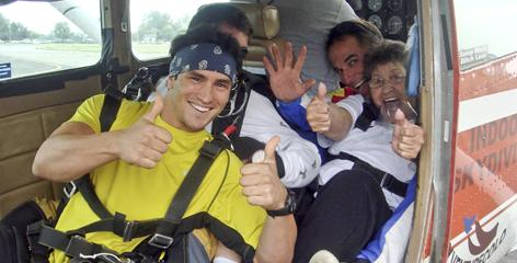 Jeremy Bloom, front, gives the thumbs-up for take off for a sky dive with Wish of a Lifetime wish recipient Lucy Gallegos, right. Behind Gallegos is Colorado Sky Sport instructor Randall Fortner. Gallegos watched a film about paratroopers when she was 8 years old and always wanted to jump from a plane. She had a hip replacement just months prior to the jump but got her wish through Bloom's foundation.