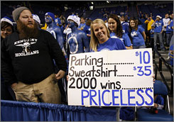 A Kentucky fan displays a sign before the game against the Drexel Dragons in preparation for the Wildcats 2,000th win. Kentucky rolled to a 88-44 rout.