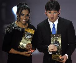 Martal and Lionel Messi pose with their trophies after both were named FIFA World Player of the Year.