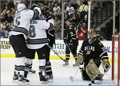 The San Jose Sharks celebrate one of their four goals in their eighth win against Dallas in the last nine meetings.