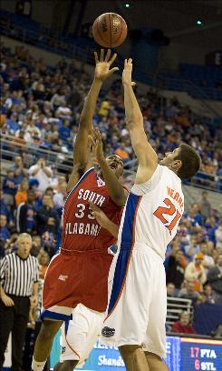 South Alabama's Tim Williams shoots over Florida's Dan Werner on Tuesday night in Gainesville, Fla. South Alabama defeated No. 18 Florida 67-66, for Florida's third consecutive loss.