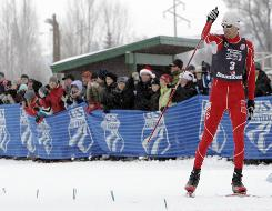 Johnny Spillane crosses the finish line to win the U.S. Nordic combined Olympic trials competition in Steamboat Springs, Colo.