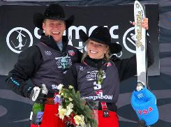 Jeret Peterson, left, and Lacy Schoor take the podium after winning the freestyle aerials trials Thursday in Steamboat Springs, Colo.