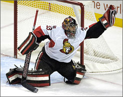 Senators goalie Pascal Leclaire, gloving the puck on a wide shot by the Buffalo Sabres, made 20 saves in Ottawa's 3-2 shootout win.
