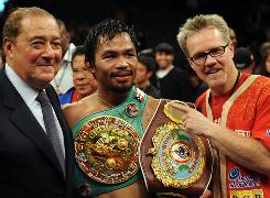 Manny Pacquiao, center, poses with promoter Bob Arum, left, and trainer Freddie Roach after defeating Miguel Cotto on Nov. 14.