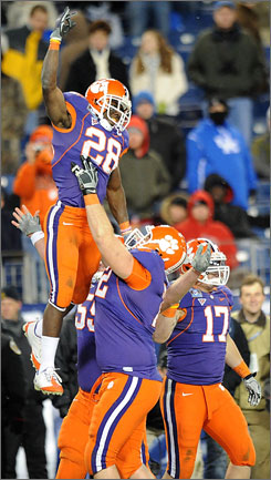 Clemson running back C.J. Spiller (28) is lifted into the air by teammates after scoring a second-half touchdown against Kentucky.
