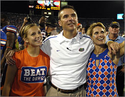 Urban Meyer, wife Shelley, right, and daughter Gigi celebrate after the Gators beat Georgia on Oct. 31.