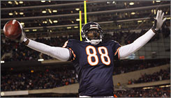 Bears tight end Desmond Clark celebrates after his second-half touchdown against the Vikings. The Bears stunned the Vikings, winning 36-30 in overtime