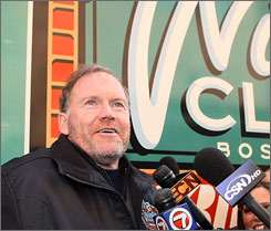 Dan Craig, the NHL's facilities operations manager, holds court in front of the refrigeration truck that will help keep the ice at the proper temperature for the Winter Classic at Boston's Fenway Park.