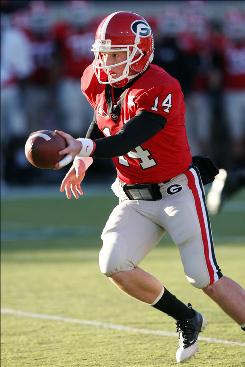Georgia quarterback Joe Cox looks to hand off against Texas A&M during the first half of the Independence Bowl. Cox threw two touchdown passes in the Bulldogs' 44-20 victory.
