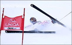 Lindsey Vonn crashes during the first run of the World Cup giant slalom in Lienz, Austria. The American hurt her left arm and was hospitalized, but doctors say she could compete in Tuesday's slalom.