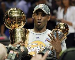 Kobe Bryant holding the Larry O'Brien championship trophy and finals MVP trophy after the Lakers beat the Orlando Magic 99-86 in Game 5 of the NBA Finals in June.