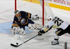 Sabres goalie Patrick Lalime, left, stopped all 27 shots he saw in relief of teammate Ryan Miller, who was pulled after surrendering three goals in 22 minutes Tuesday against the Penguins. Buffalo rallied to beat Pittsburgh 4-3.