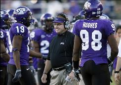 Coach Gary Patterson, center, will lead TCU to its first major bowl appearance in half a century when the Horned Frogs face Boise State Jan. 4 in the Fiesta Bowl.