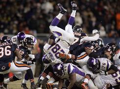 The Vikings' troubles were evident again in Monday night's loss to the Bears. Adrian Peterson, here getting upended by the Chicago defense, managed 137 yards rushing but had a critical fumble that allowed the Bears to come away with the win.