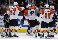 The Philadelphia Flyers' Simon Gagne, center, celebrates with teammates Danny Briere (48), Mike Richards (18), Jeff Carter (17) and Kimmo Timonen after scoring against the New York Rangers in the second period. Gagne ended with a hat trick and an assist in the Flyers' 6-0 victory.