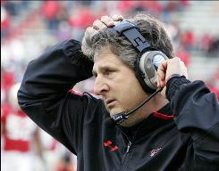 Texas Tech fired head coach Mike Leach on Wednesday just before the two sides were to appear in a Lubbock, Texas, courtroom for a hearing on the coach's suspension.
