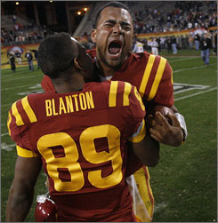 Iowa State's Austen Arnaud and Keith Blanton Jr. celebrate their Insight Bowl victory against Minnesota.