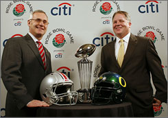 Ohio State's Jim Tressel, left, and Oregon's Chip Kelly face off on Friday.