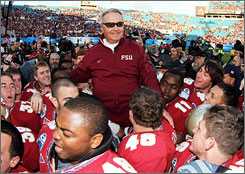 Florida State coach Bobby Bowden is carried off the field by his team after he ended his career with his 389th victory.