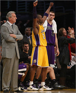 Kings coach Paul Westphal watches with his arms crossed as the Lakers' Kobe Bryant celebrates his buzzer-beating three-pointer.